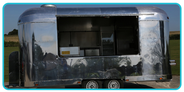 Open hatch view of airstream catering trailer